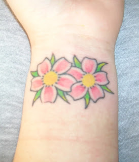 Cool Japanese Cherry Blossom Tattoo On Wrist Picture 7