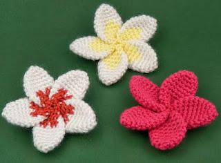 http://www.planetjune.com/blog/free-crochet-patterns/plumeria/