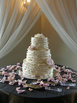 3-tier round fondant frill with gumpaste flowers