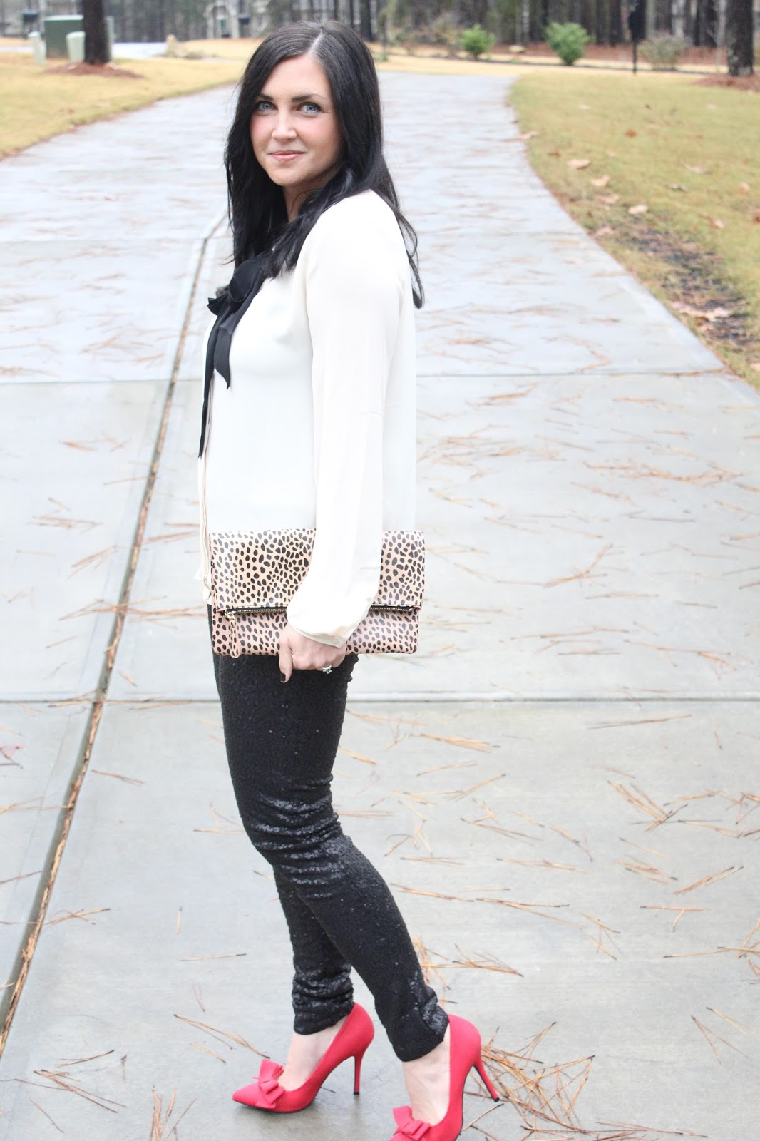 bow blouse, sequin pants, leopard clutch, red heels
