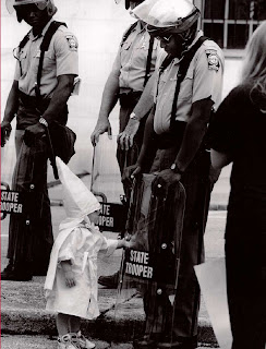 KKK Toddler with Black Cop