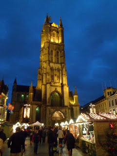 St Bavo cathedral by night with Christmas market in Ghent, Belgium