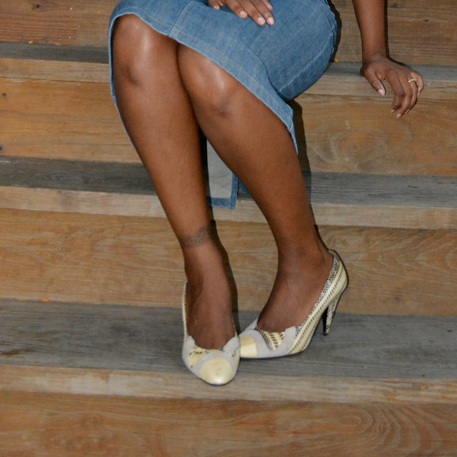snakeskin pumps worn with denim outfit