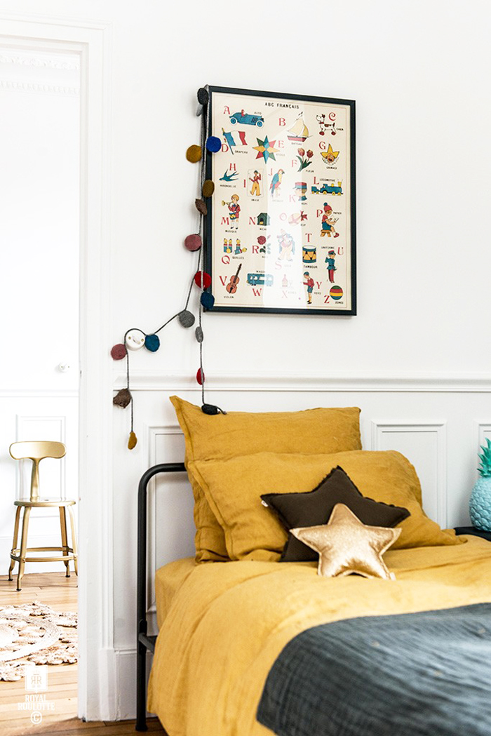 Gold ochre bedding linen in children's room