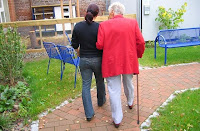 Senior and caregiver on a walk