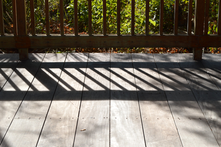 shadows on planks of wood