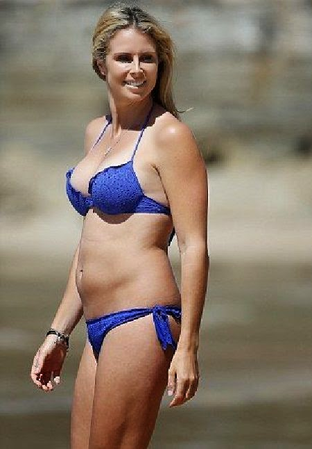 Candice Falzon slips into a Blue Bikini in Manly beach,‭ ‬Sydney