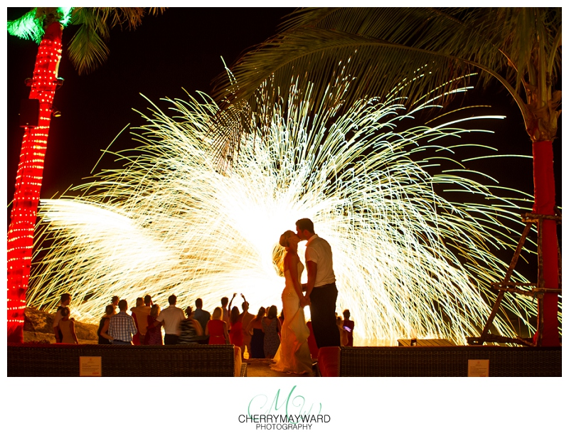 Bride and groom Kiss with firedancer backdrop, stunning photo, beautiful photo, wonderful moment, Bride and groom kiss at night, Koh Samui Wedding, Beach Republic