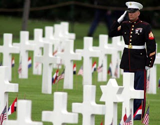 soldier at memorial grave pic