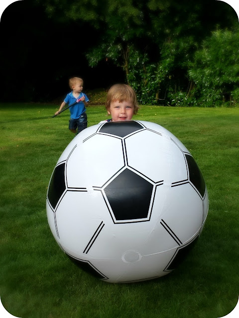 toddler with giant football, 90th family party