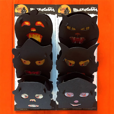 A folio package of pumpkin, witch, scarecrow, cat, devil, and clown silhouette Halloween slot-tab containers or lanterns by Bindlegrim