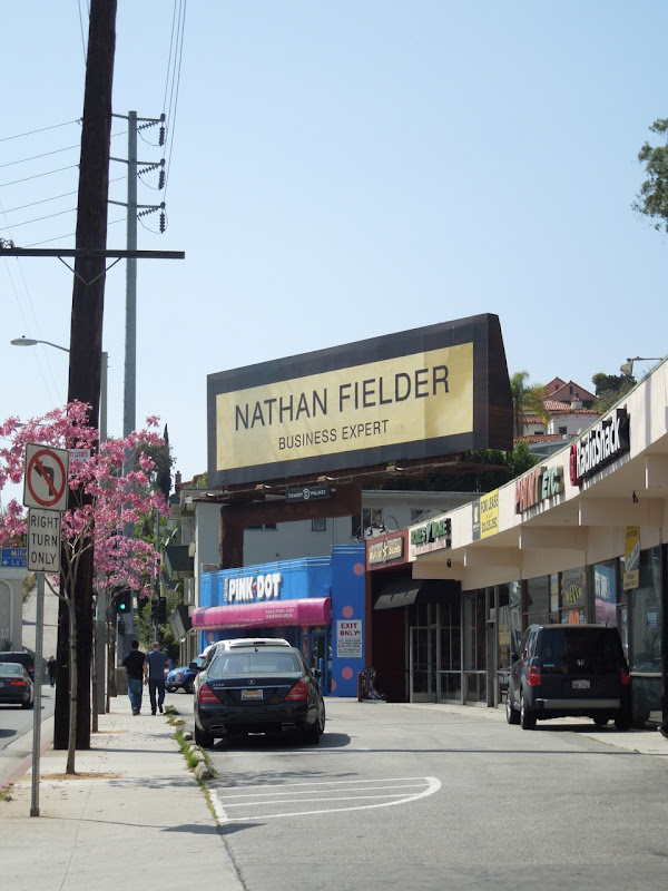 Nathan Fielder gold name plate billboard