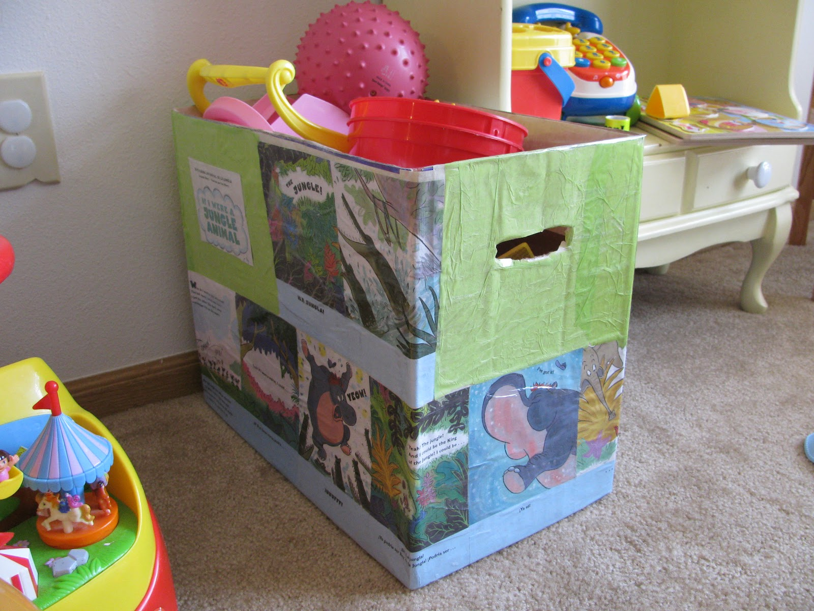 Cover diaper boxes with colorful paper for free toy storage.