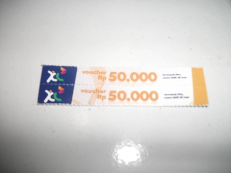 2 voucher pulsa 50000