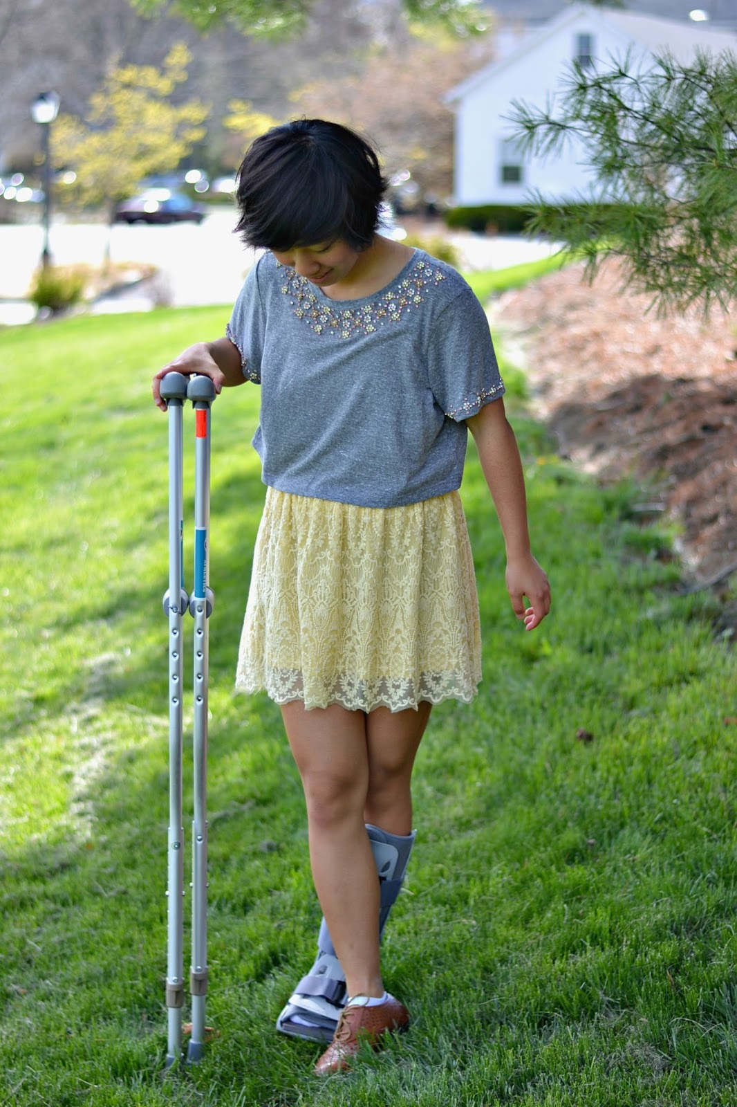 dressing with crutches and walking boot