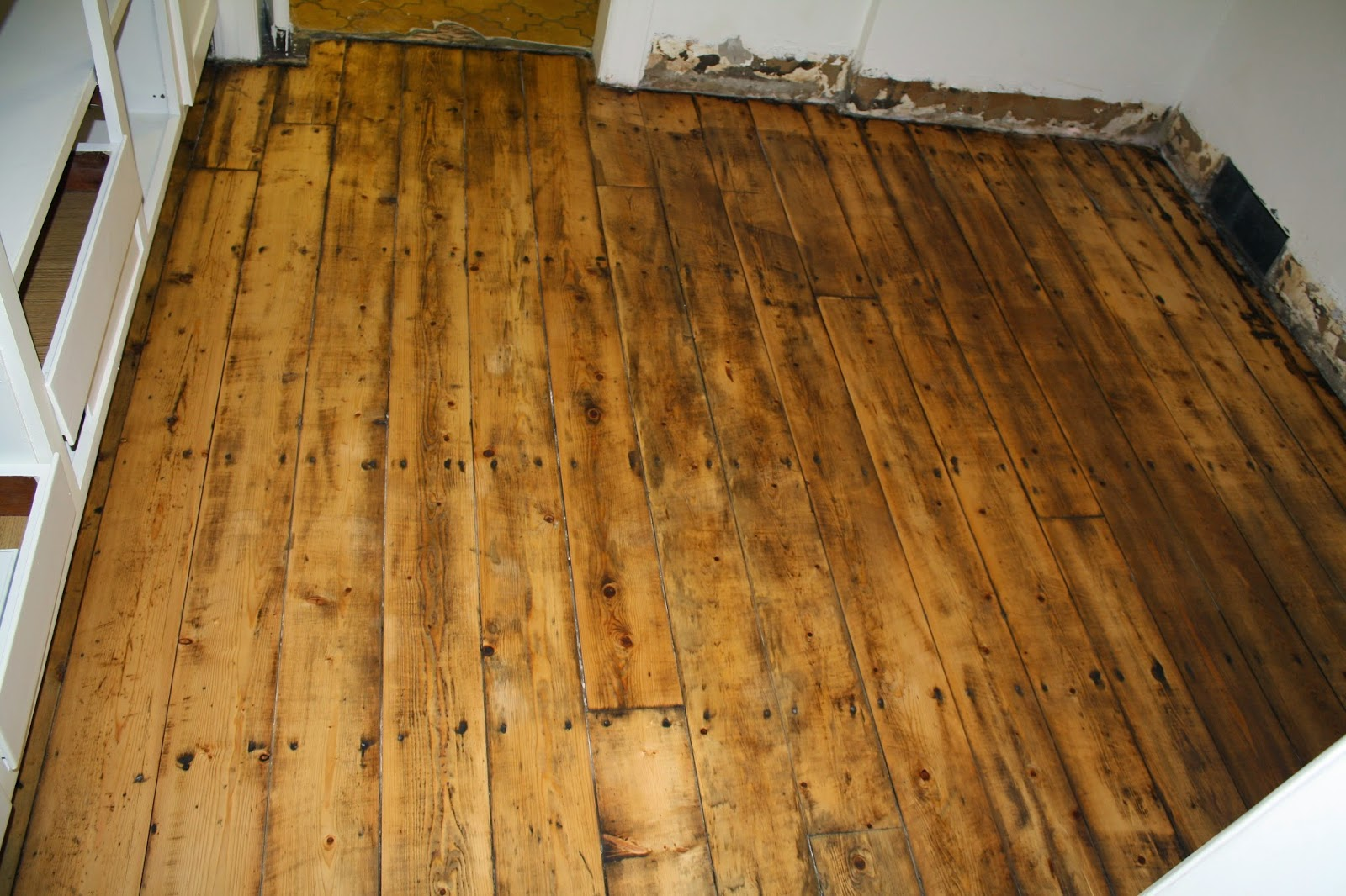 Restoring the splendor old house restorations old home for Hardwood floors uneven