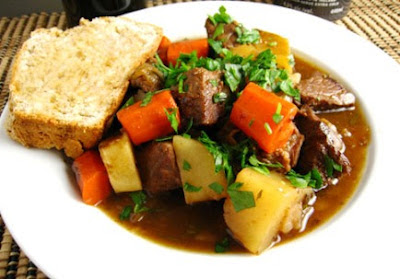 Picture of Traditional Irish Stew on a white soup bowl and bread