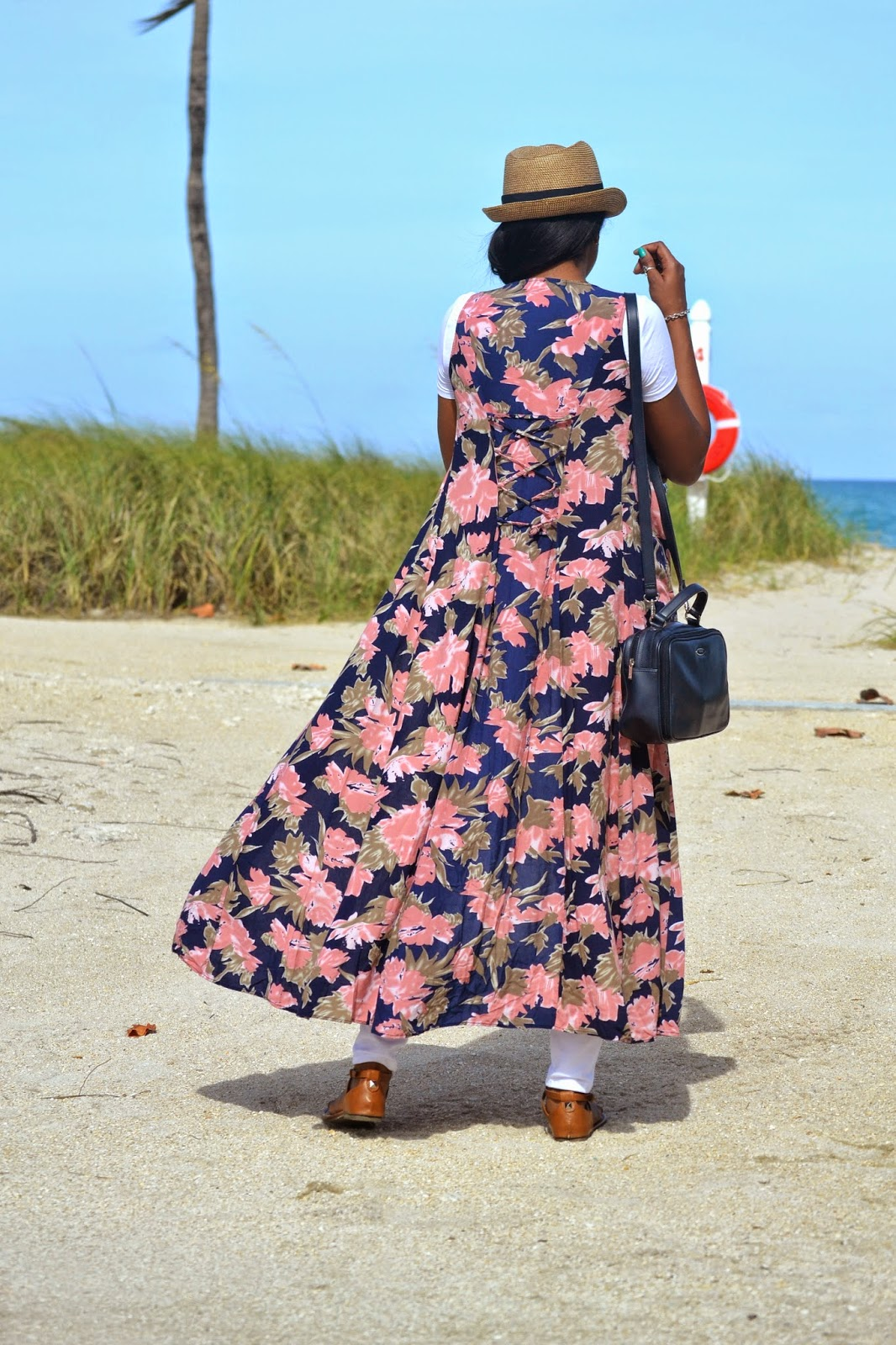 relaxed vacation style wearing open reverse floral print dress