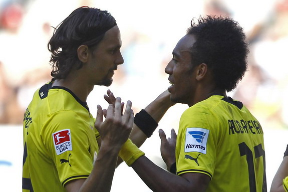 Dortmund's Pierre-Emerick Aubameyang celebrates a goal against Augsburg with Neven Subotić