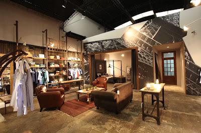Inaugur loft designed by una tienda de ropa muebles y for Loft muebles