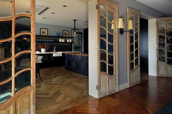 gran cocina negra y madera natural decoración moderna patricia stewart