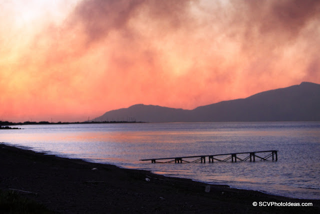 Dawn colors covered by wildfire smoke on the beach