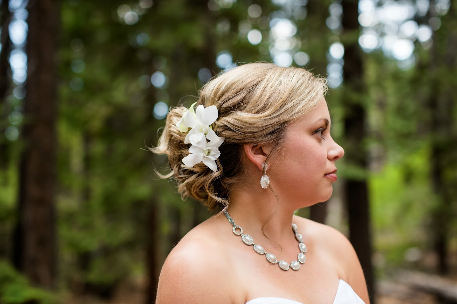 bridal up do with flower  // Huong Forrest Photography // Take the Cake Event Planning