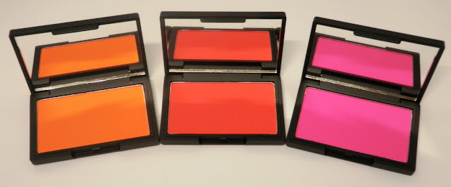 Review and swatches of Sleek makeup blushes orange Aruba, red Scandalous and pink Santorini.