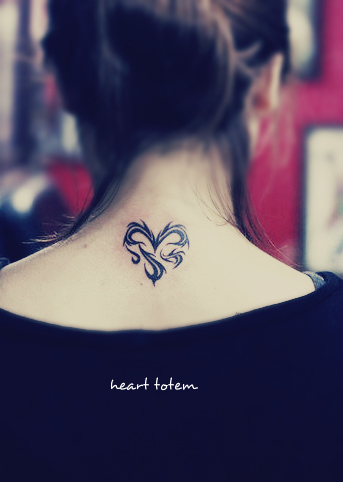 a heart tattoo on the back consist with totem type of lines