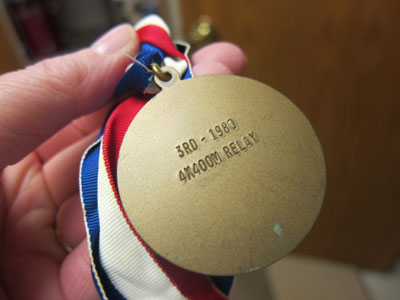 Medal with patriotic ribbon from a relay race