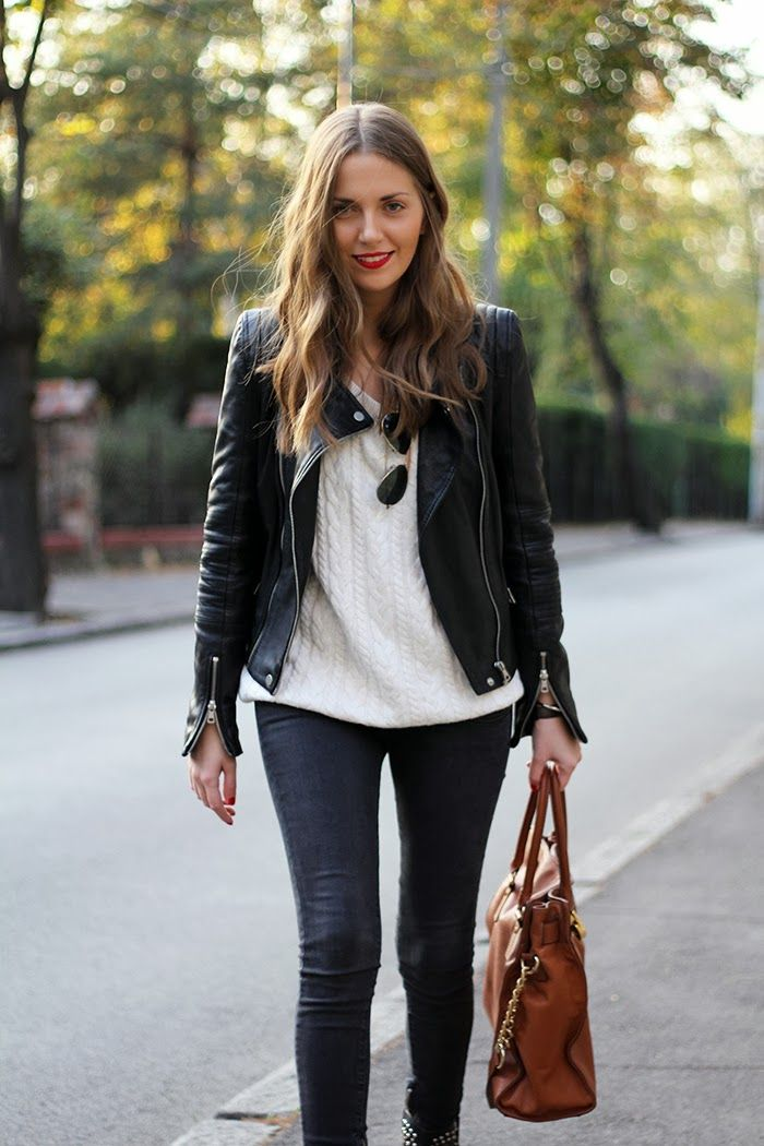 White sweater, brown tote bag and leather coat