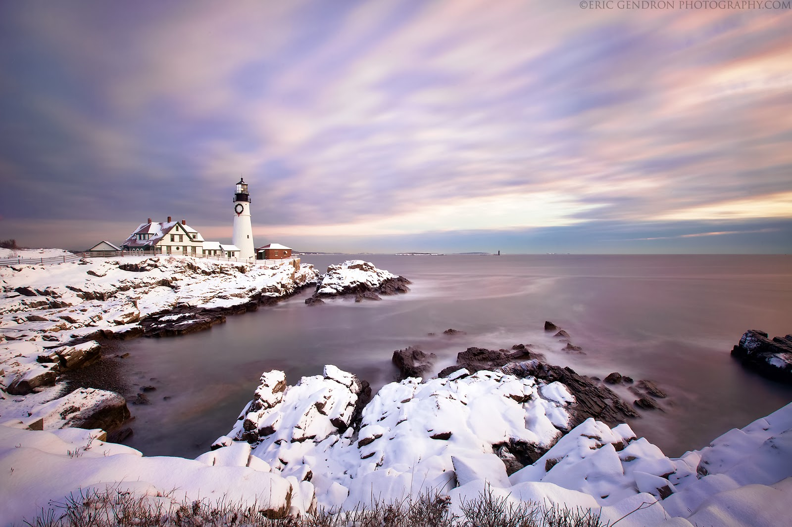 winter snow at portland head lighthouse maine