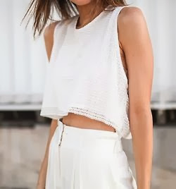 street style capture winter white in crop top and high waisted trousers