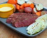 Caraway Corned Beef with Red Potatoes, Carrot Chunks, Cabbage Wedges & Cheese Sauce