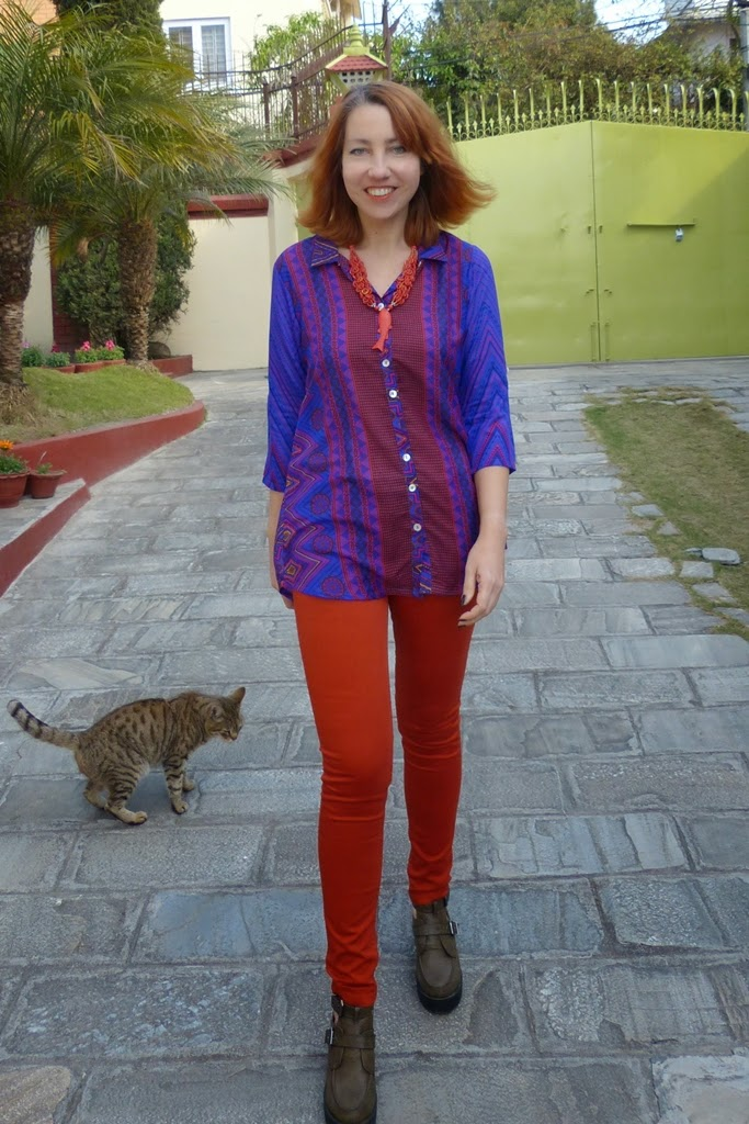 Rusty orange skinny pants and contrasting printed blouse