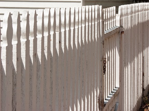 Photo of white picket fence for mending fences