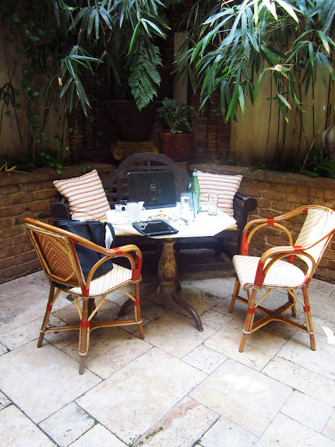 A table in the courtyard in action