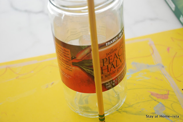 glueing on the first pencil for a pencil vase