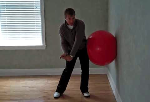 Using a balance ball to train your downswing