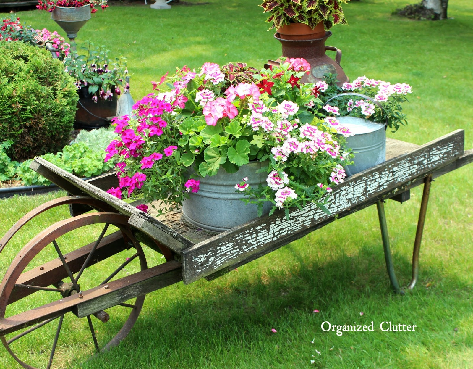 Rustic garden wheelbarrow 2015 organized clutter for Rustic outdoor decorating