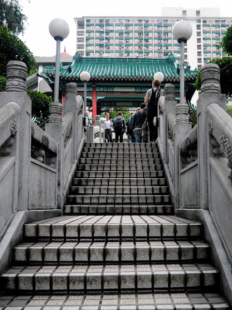 Stairs to the bridge crossing the pond in the garden of Sik Sik Yuen Wong Tai Sin Temple, Hong Kong