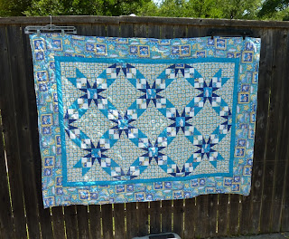 big baby quilt in blue angel fabrics