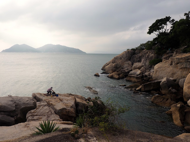 Rocks by the ocean, neat Cheung Po Tsai cave and Reclining Rock on Cheung Chau Island, Hong Kong