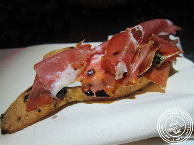 Image of Mozzarella, prosciutto and pesto Bruschetta at Courgette next to Dream Hotel Midtown in NYC, New York