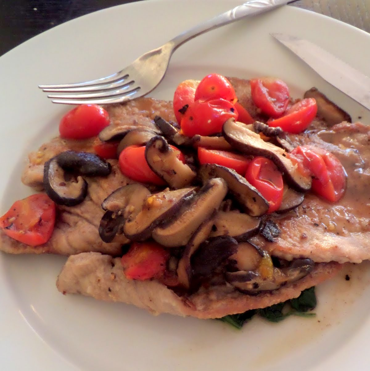 Veal Scallopini:  thin veal cutlets with tomatoes, mushrooms, and spinach in a white wine sauce.
