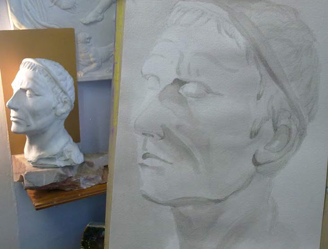 busto de escayola y dibujo a tinta