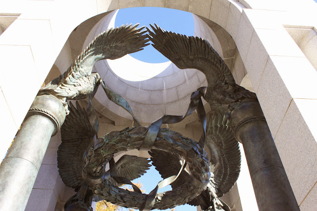 The beautiful arch with birds and ribbons at War World II Memorial in Washington DC, USA