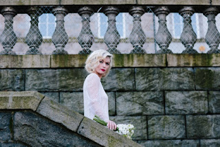 Vintage style shoot with blonde model in a vintage wedding dress with finger waves and red lipstick