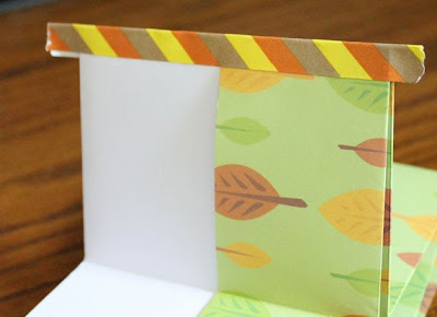 book made from a sheet of scrapbook paper