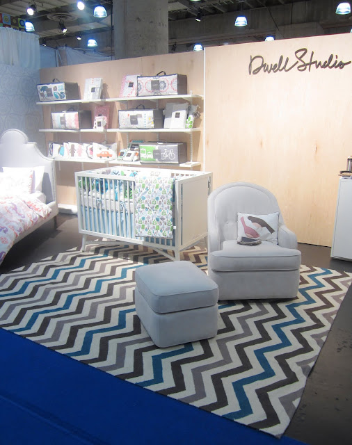 multicolored brown, blue and taupe chevron rug in Dwell Studio's booth at the New York International Gift Fair